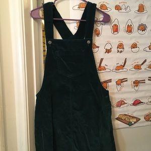 Deep green corduroy overall dress